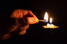 Candle and match